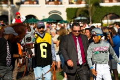 Jockey Victor Espinoza gives Chrome the eye.