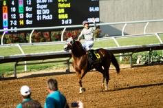Jockey Victor Espinoza waves to the crowd as Chrome struts!